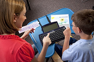 Laura Badger, M.S. '10, and her client use a DynaWrite communication board. Photo by Bill Truswell