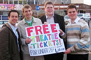 From left: Parliamentary candidate Kevin Bonavia joins intern Zach Tomanelli '11 and two campaign supporters outside Cliffs Pavilion Theatre in Southend-on-Sea, England, to promote the Labour Party's free theater ticket program. Photo courtesy of Zach Tomanelli '11