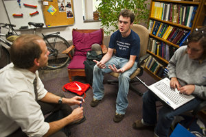 Professor Pfaff meets with students in his office. Photo by Mike Grippi '10