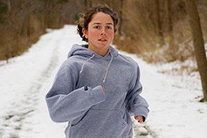 Norah Shipman '10 runs after a light snowstorm. Photo by Kyle Kelley '10