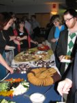 Reception attendees choosing food from the catered buffet