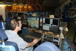 """FORCAST team leader, Terry Herter, operating the camera from the """"PI Rack"""" instrument console on SOFIA."""