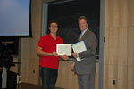 Alex LLaurado, semifinalist, accepts congratulations from Professor Michael Whelan