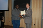 Akin Oni-Orisan, semifinalist, accepts congratulations from Professor Michael Whelan