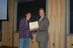 onnor O'Farrell, semifinalist, accepts congratulations from Professor Michael Whelan