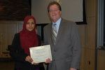 Abida Afros, finalist, accepts congratulations from Professor Michael Whelan