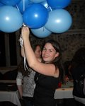 Julia juggles blue balloons to decorate!