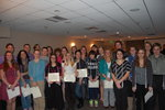 Group shot of the 2011 inductees with their cords and certificates
