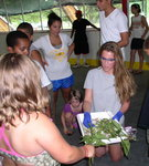 Samantha (Chem '12) letting the children beak flowers that were treated with liquid nitrogen.