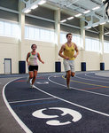 Runners use the indoor track at the Athletics and Events Center.