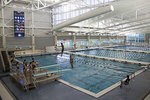 Students practicing diving in the A&E Center's pool