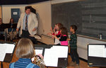 Children try their hand at conducting, coached by Keith Kaiser