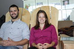 Senior Jeff Hatzel and Tricia Santelli, test out Jeff's senior integration project,  two-person Adirondack Chair.
