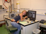 JJennifer Bell (Env. Sci. 09) using a scanning electron microscope at Cornell Center for Materials Research.
