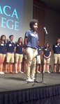 Orientation Leader speaking on stage