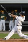 A Ithaca College baseball player takes a big swing during a game.
