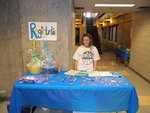 PRSSA event co-chair works the registration table at Swish for Make-A-Wish on April 20 in the Fitness Center Mondo Gym on Ithaca College's campus.