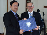 Chancellor of Shanghai University of Sport Dai Jian (left) and Ithaca College President Dr. Thomas Rochon