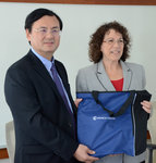 Chancellor of Shanghai University of Sport DAI Jian and HSHP Dean Linda Petrosino exchange gifts.