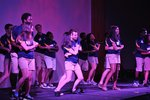 orientation leaders dancing on a stage