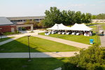 This is a scenic view of the quad in front of Park with a tent for the barbecue.