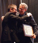 Jeremy Scahill Receiving I. F. Stone Hall of Fame Plaque from Jeff Cohen