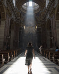 Woman walking down the Basilicas