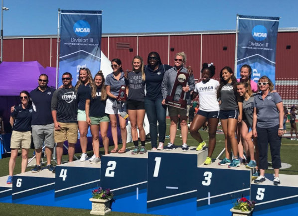 Women's track & field standing on the championship podium