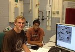 Kyle Clifford (Chemistry '14, left) working at Sigma Aldrich.
