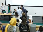 picture of me signing books for students at Leeds University