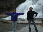 "Two  therapeutic recreation students spell ""TR"" at Buttermilk Falls in Ithaca"