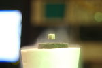 A magnet levitating above a superconductor