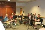 A contrabasson ensemble performs