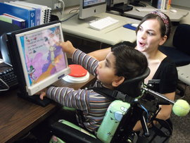 Teacher Assisting Learning Disabled Student by Ithaca College