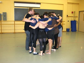 A group hug before a rehearsal.