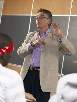 A health promotion and physical education professor leads a classroom discussion.