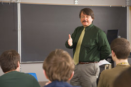 A history professor leads a classroom discussion.