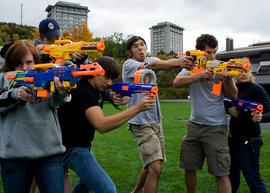 A human strike team takes aim at approaching zombies on the academic quad.  Photo by Matthew Watkajtys '11