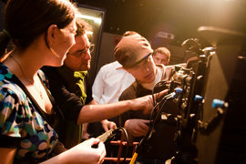 A professor and students work with a JVC HM700 camera in an advanced cinema production class.