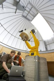 A student and professor at work in the Ithaca College observatory.