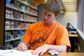 A student at work in Gannett Library.