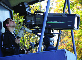 A student camera operator captures the action for ICTV.