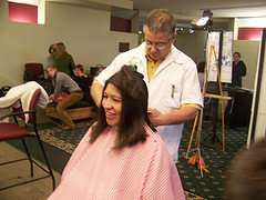 A student gets her hair trimmed for Locks of Love.