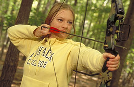 A student in an archery class at Ithaca.