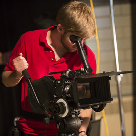 A student operates a video camera