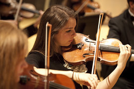 A student performs in a Chamber Orchestra concert.