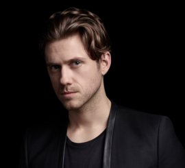 Aaron Tveit '05 | Photo by Gavin Bond/USA Network