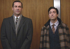 Ad men Don Draper (Jon Hamm) and Michael Ginsberg (Ben Feldman) share an elevator. Photo credit: Courtesy of AMC