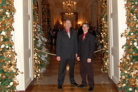 Adam Strube '08 and Carl Ruck, M.M. '81 at the White House, December 2007
