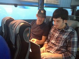 Adam and Jesse on a bus